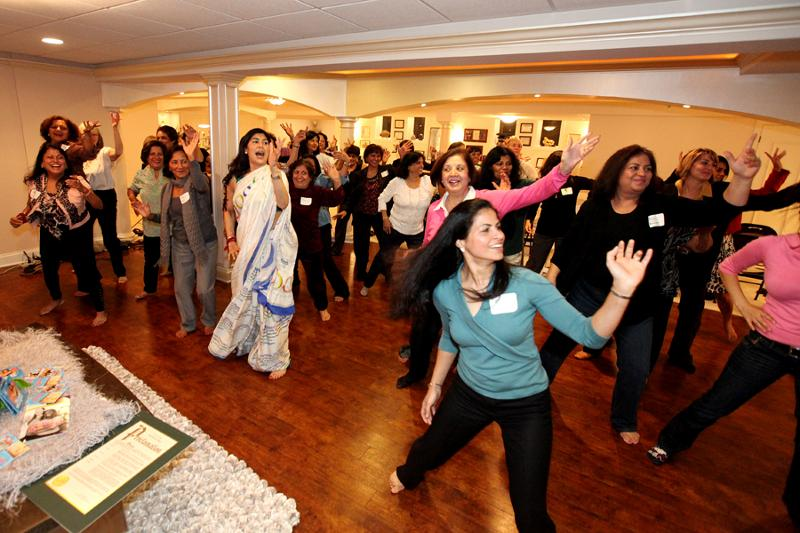 Sarina demonstrating to group Masala Bhangra Workout