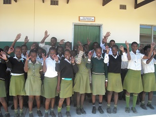 Learners in front of a new classroom at Gobihlahla School, built with funds raised by 2012 Learning Tour participants.