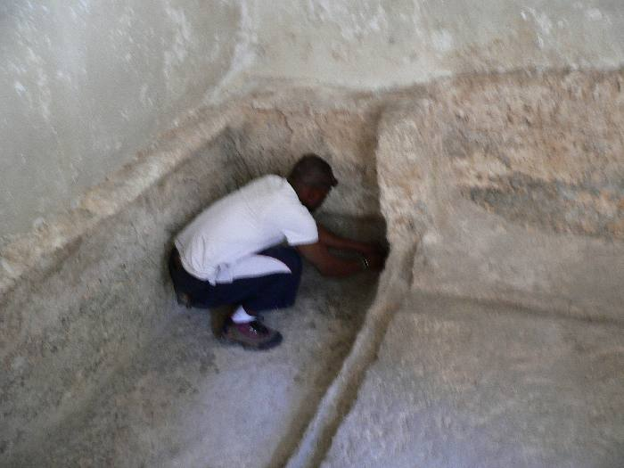 Peter measuring the grave of Jesus in the Garden Tomb,