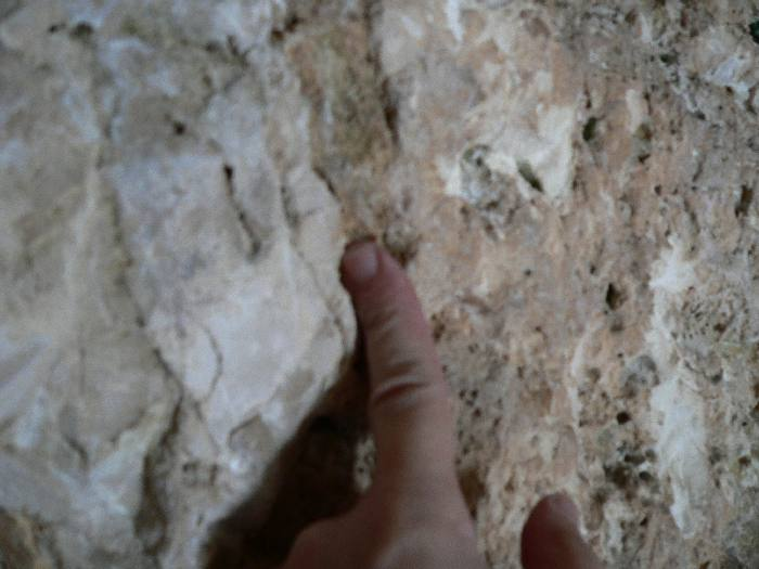 Simon Brown pointing at chisel marks inside the Garden Tomb