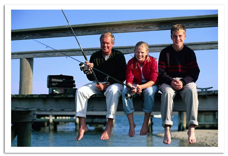 dad fishing with children