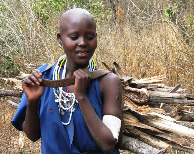 Maasai woman carrying wood