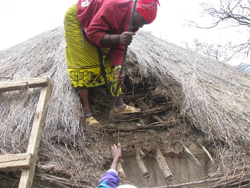 Maasai women installing a chimney