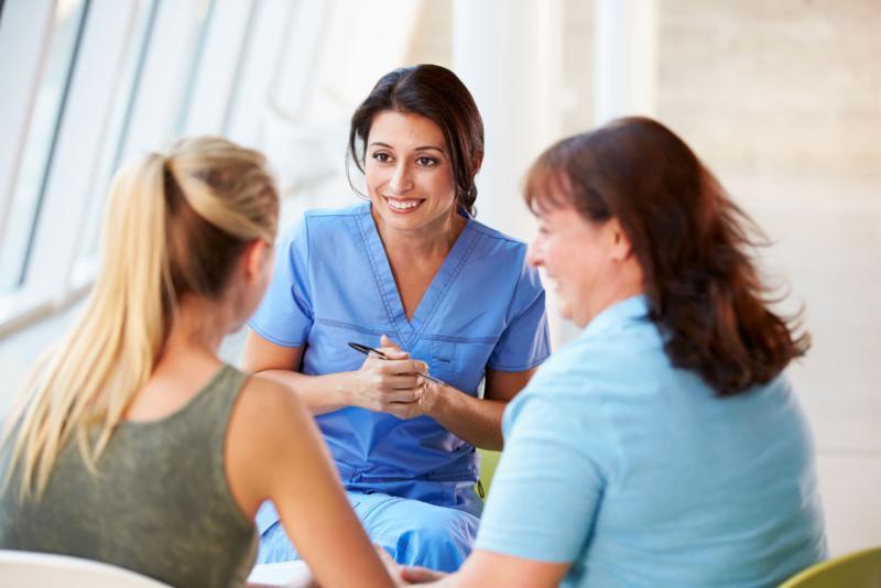 Nurse counseling patients
