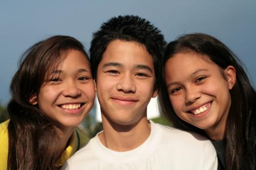 Three smiling teens