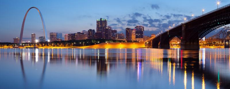 Panoramic image of St. Louis downtown with Gateway Arch at twilight.