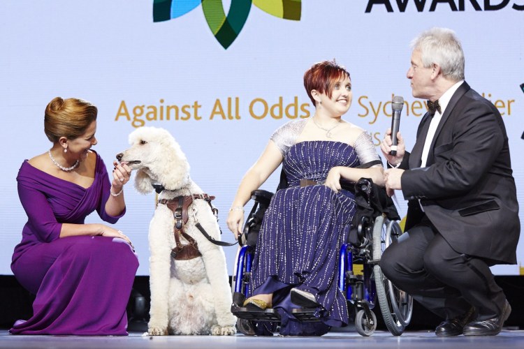 FEI Awards 2014 - Against All Odds: Sydney Collier (USA) with her service dog Journey and HRH Princess Haya talks to retiring FEI Endurance Director Ian Williams, co-Master of Ceremony for the evening