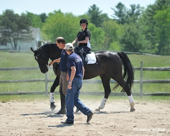 Coaches Kai Handt and Wes Dunham demonstrate working together with rider Sydney Collier and horse Wentworth