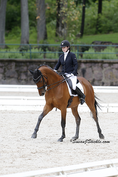 Angela Peavy and Ozzy Cooper (Trak), owned by Rebecca Reno (Grade III). Photo copyright SusanJStickle.com. Photo is taken in Gladstone, NJ at  the 2014 USEF Para-Equestrian Dressage National Championship/ Selection Trial for the Alltech FEI World Equestrian Games™ (WEG).