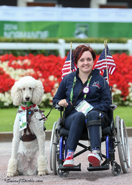 Sydney Collier and her dog Journey. Collier's dog Journey became a media sensation at the 2014 Alltech FEI World Equestrian Games. Photo copyright SusanJStickle.com