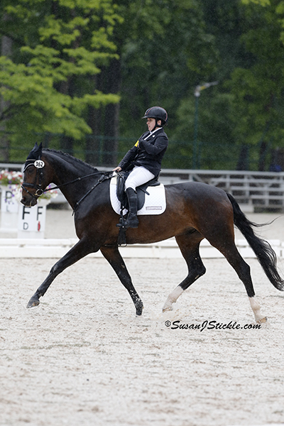 Sydney Collier (Grade Ib) and NTEC Cuplee (Warmblood), owned by Victoria Dugan. Photo copyright SusanJStickle.com. Photo is taken in Gladstone, NJ at the 2014 USEF Para-Equestrian Dressage National Championship/ Selection Trial for the Alltech FEI World Equestrian Games™ (WEG).
