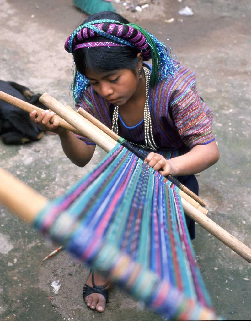 girl w loom by richard nelson