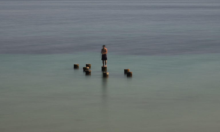 Boy Standing on Piling