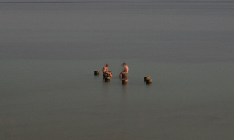 Two Boys on Pilings