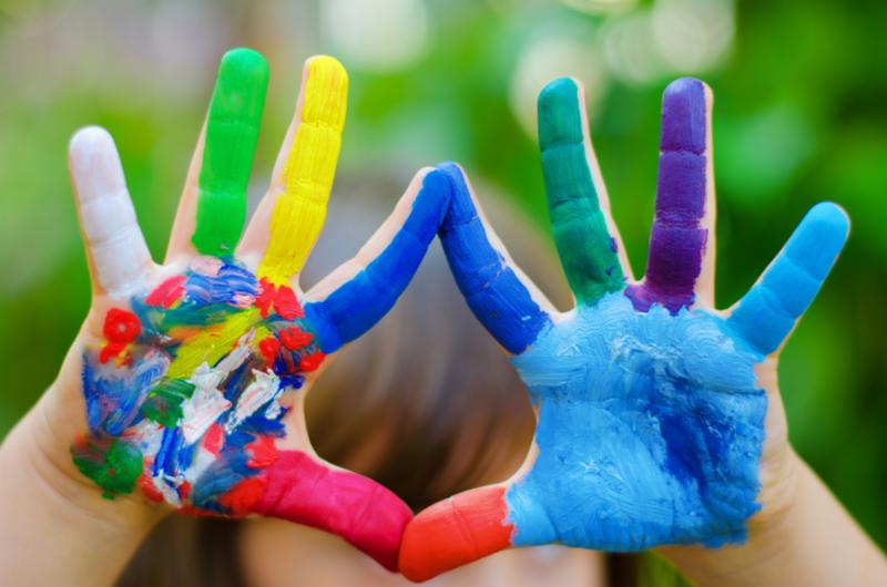 Child s hands painted in different bright colors     Note  Slight blurriness, best at smaller sizes