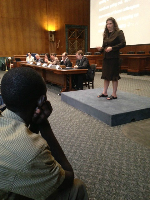 Deaf Ugandan advocate sits in front  row of event