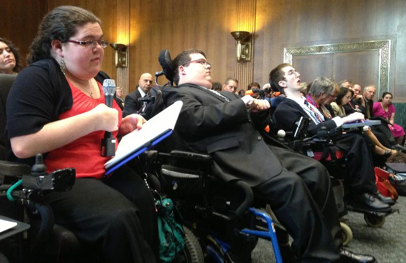 Young interns with disabilities sit in front of briefing and partiipate in Q&A