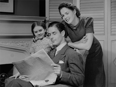 Family Reading Newspaper - Old Media