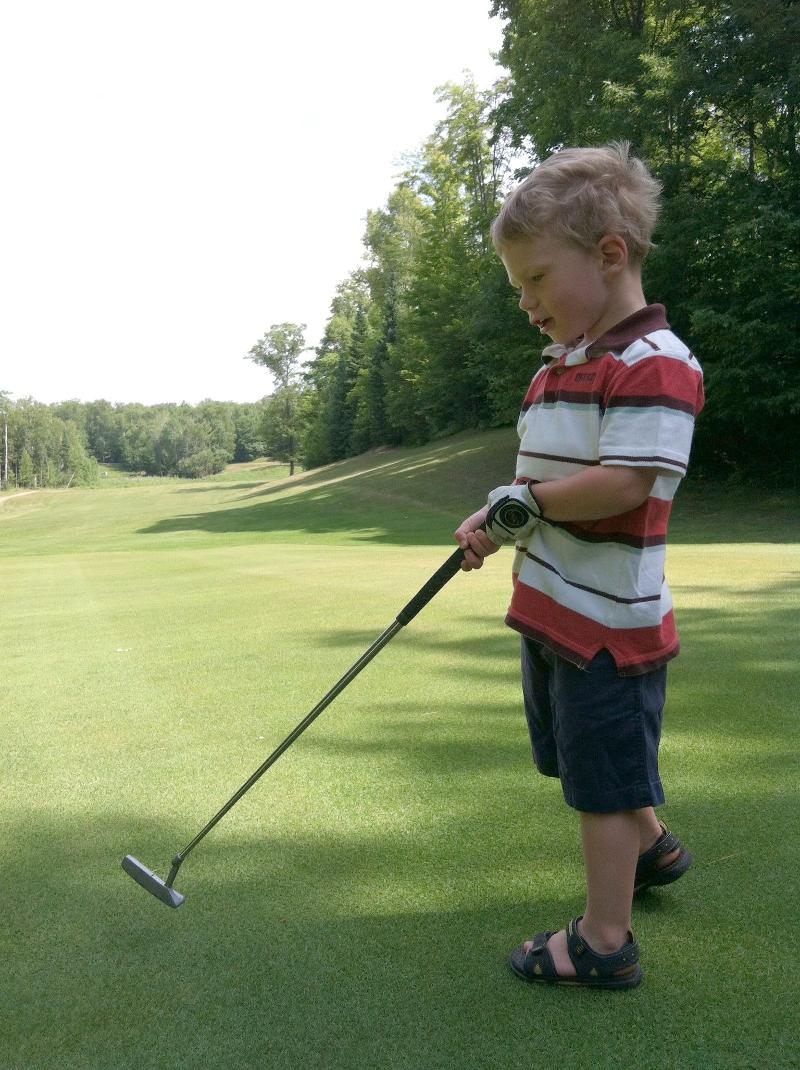 Tristan golfing 2013