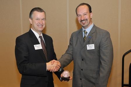 Rick Tucker receiving award from Gerald Kolasch, NAITA President