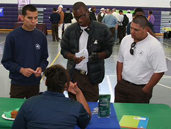 Sacramento Job Corps students talk with a potential employer