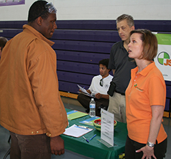 Sacramento Job Corps student talks with representatives from JS Contracting