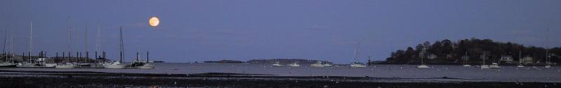 Photo of moon rising over Salem Sound