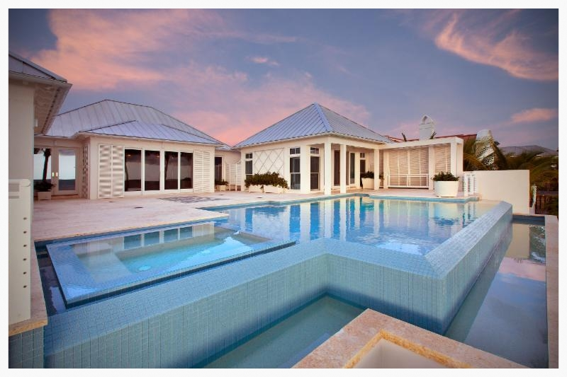 The house and contemporary styled pool are built on pilings 14 feet above the existing flood grade.