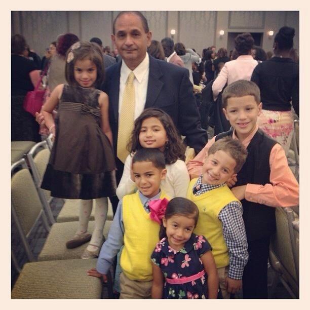 Sammy Rosario and his grandchildren.