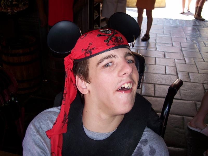Nick with a Disney hat on with mickey ears and a pirate scarf.