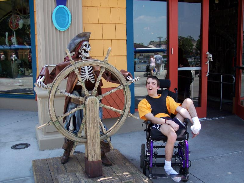 Nick next to a skeleton at the Pirates of the Caribbean ride at Disney.