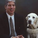 Mr. Pledger and his guide dog Joelle