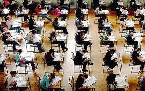 Rows of students sitting in desks taking a test