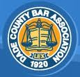 Logo for the Dade County Bar Association. it has a scale of justice in the middle and the date 1920.