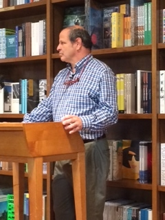 Marc Pulver standing at a podium at Books & Books