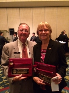 Lester and Sharon Langer winning an award from the Miami-Dade Justice Association.