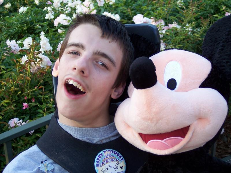 Nick with his micky mouse stuffed animal at Disney