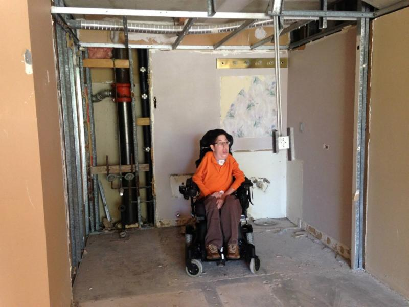 Zach Trautenberg in his new apartment that is under construction