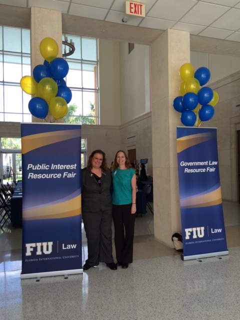 Randee Breiter and Debbie Dietz standing at the FIU Public Interest Resource Fair.