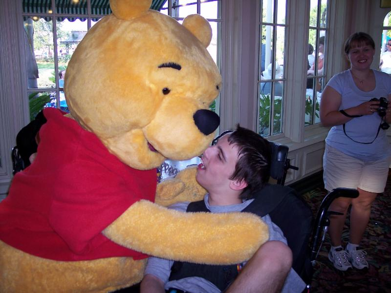 Nick getting hugged by Winne the Pooh