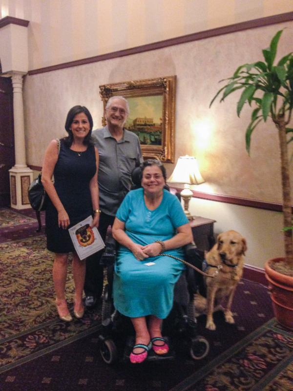 Rachel with Mr. and Mrs. Fisher and Sorenson the dog.