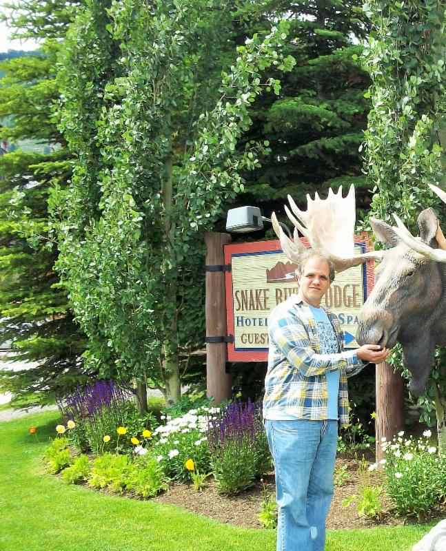 Matt standing next to the mouth of a fake moose in Jackson Hole, WY.
