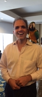 Matt with a parrot on his shoulder.