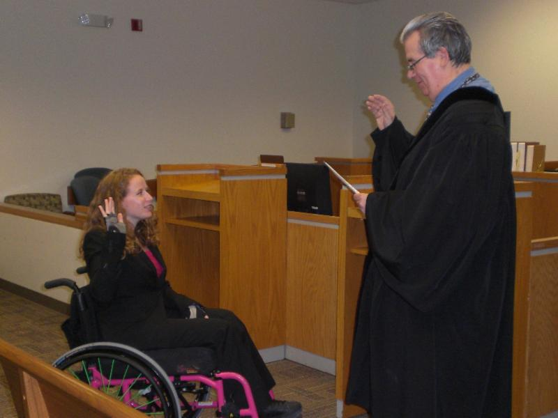 Stephanie takes the oath with Judge Cohn at her swearing in ceremony.