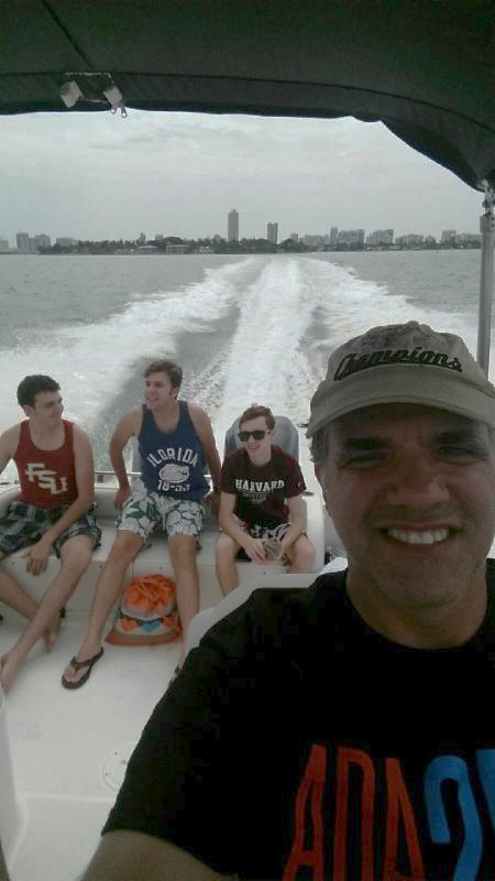 Matt on a boat in Miami Beach with Max, Ros, and Franco in the background.