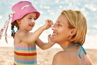 Woman and child with sunscreen