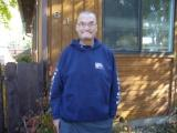 Randy in front of his home