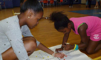 A School Age Program youth participates in a math competition.