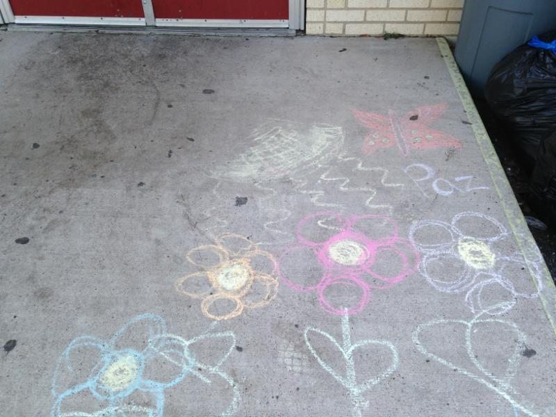 A child's drawing on the step outside the entrance of the Sacred Heart rescue center in McAllen