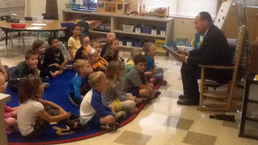 Superintendent Robison reading in the classroom